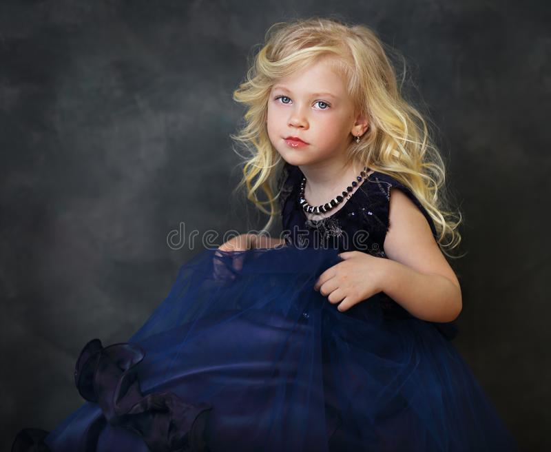 Little girl in navy blue dress royalty free stock photos