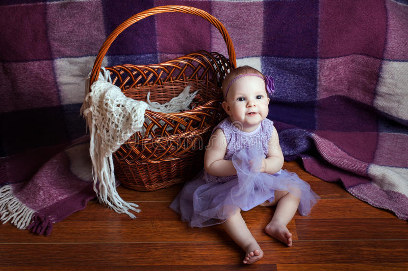 Little girl near the basket royalty free stock photos