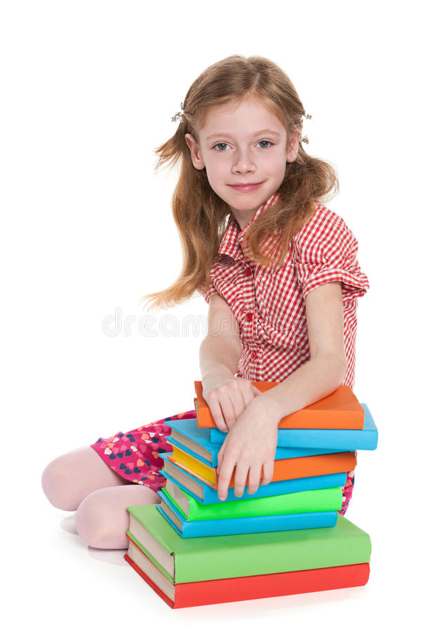 Little girl near books royalty free stock photography