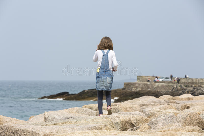 Little girl near the sea stock images