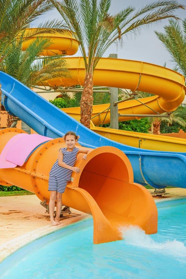 Little girl near water park slides royalty free stock image
