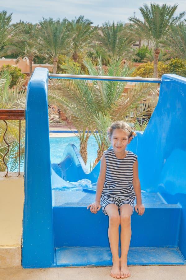 Little girl near water park slides