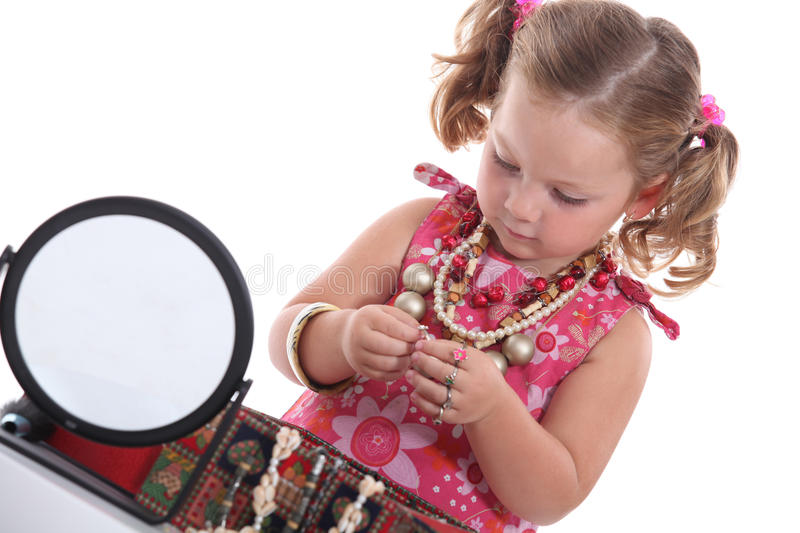 Little girl with necklaces royalty free stock photo