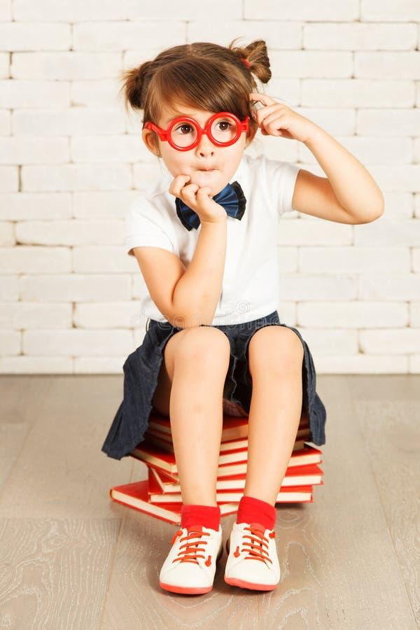Little girl nerd stock photo