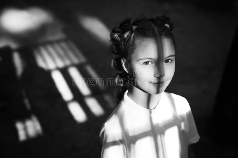 Little girl at the night playground stock photos