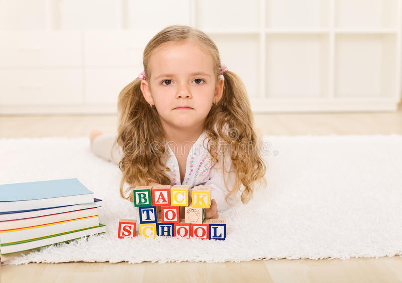 Little girl not too happy going back to school royalty free stock images