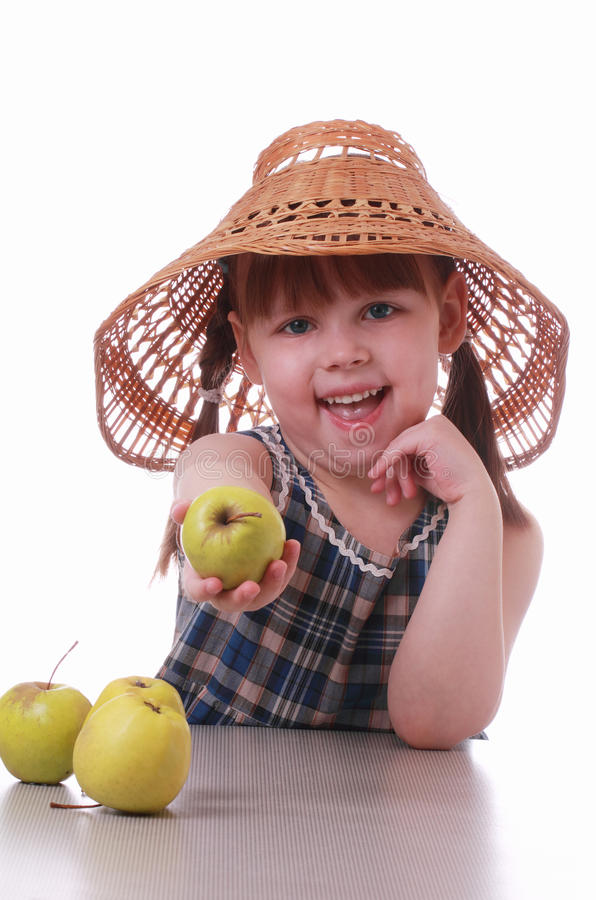 Download A Little Girl Offers An Apple Stock Photo - Image: 23478774