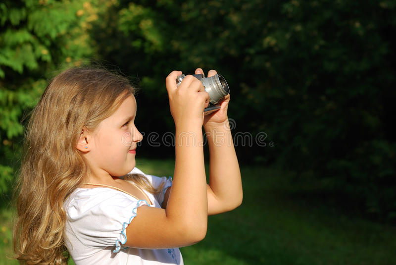 The little girl with the old camera royalty free stock photo