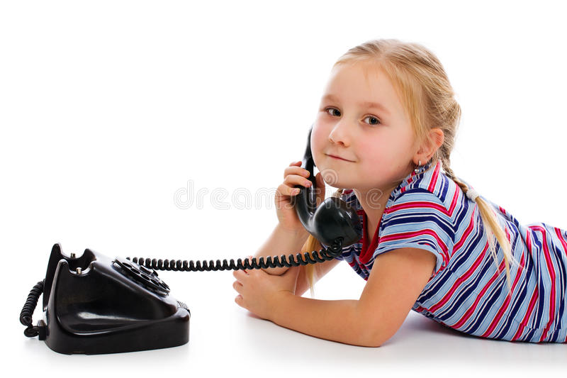 Little girl with old retro phone. stock image