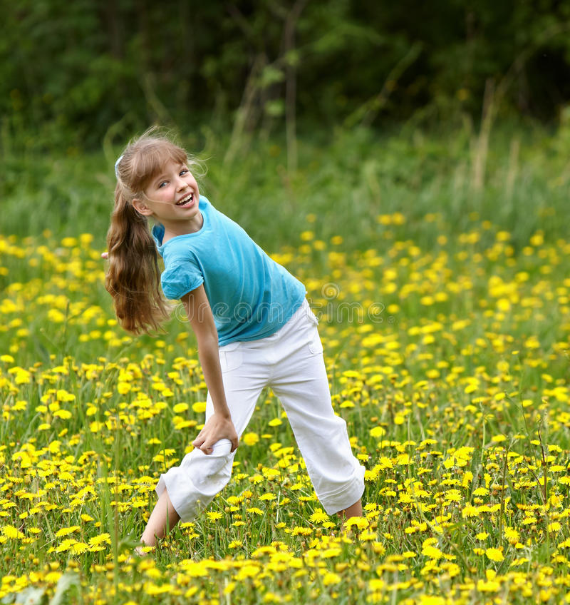 Free Little Girl On Grass In Flower At Nature. Stock Image - 14294061