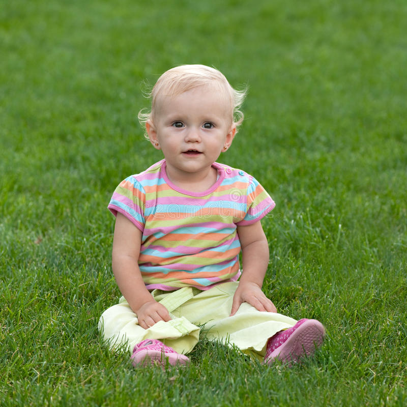 Free Little Girl On The Grass Stock Photo - 16876260