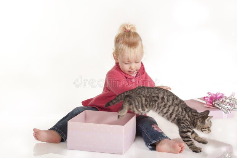 Little girl opening birthday present stock image