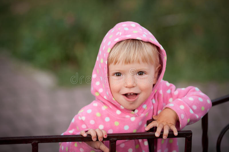 Little girl opens the gate stock photos