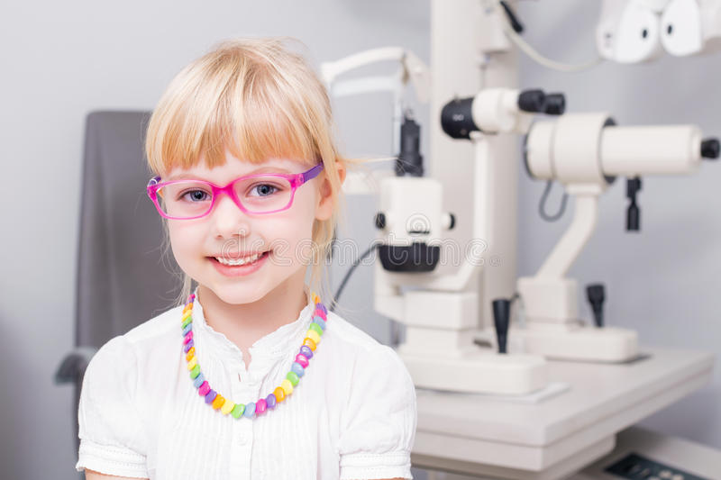 Little girl with optic glasses royalty free stock photos