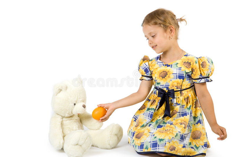 Little girl with orange and be royalty free stock photography