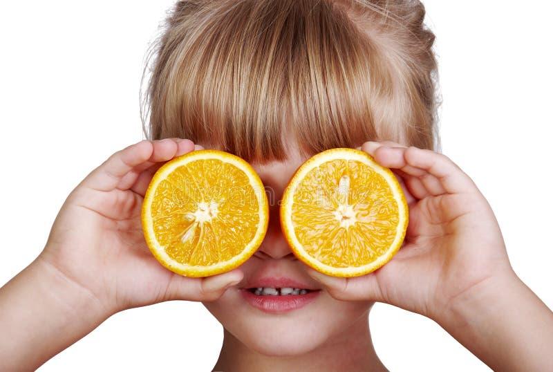 Little girl with orange stock photos