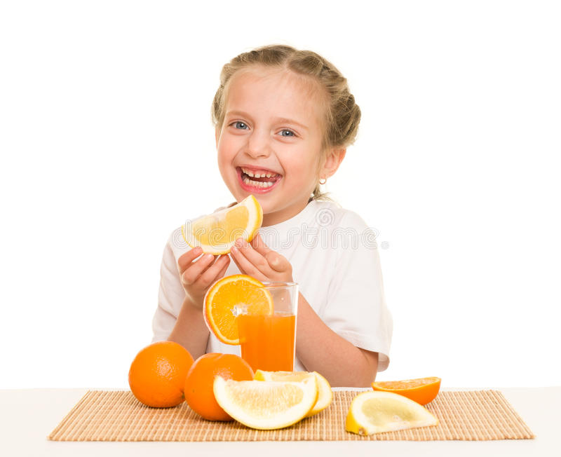 Little girl with oranges drink juice. Isolated royalty free stock photos
