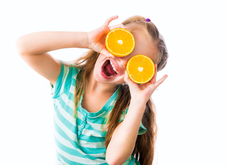 Little girl with oranges stock photos
