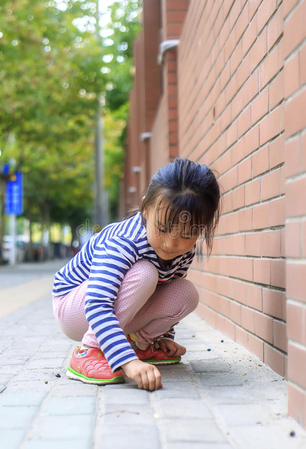 The little girl in the outdoor play. Chinese little girl in outdoor play stock image