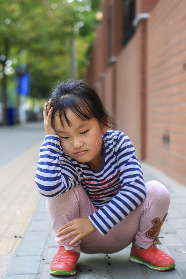 The little girl in the outdoor play. Chinese little girl in outdoor play royalty free stock photography
