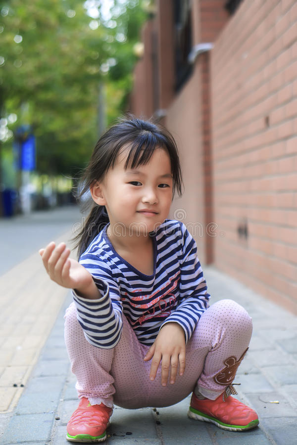 The little girl in the outdoor play. Chinese little girl in outdoor play royalty free stock photos