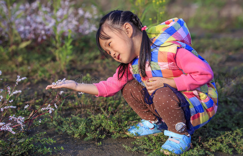 The little girl in the outdoor play. Chinese little girl in outdoor play stock images