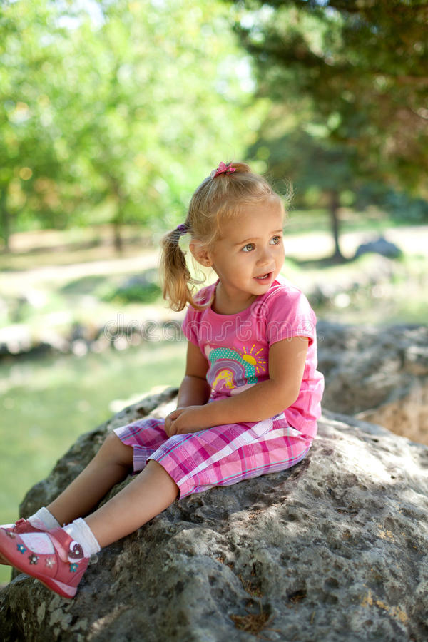 Little girl outdoors stock images