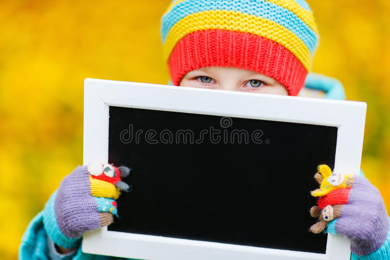 Little girl outdoors on autumn day stock photos