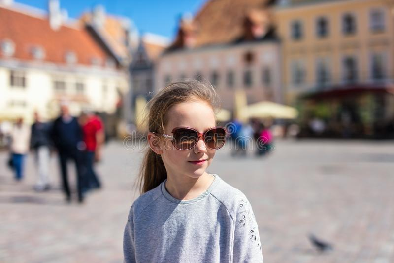 Little girl outdoors. Casual portrait of little girl outdoors in Tallinn old town on summer day stock photography
