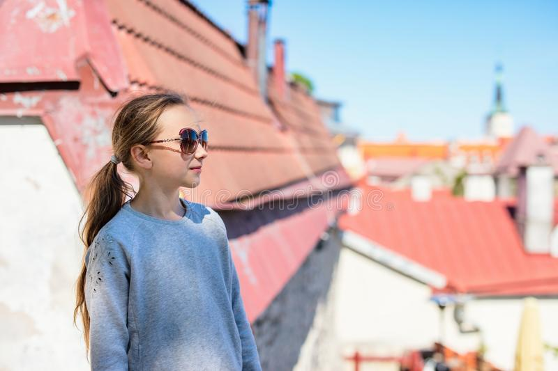 Little girl outdoors. Casual portrait of little girl outdoors in Tallinn old town on summer day stock image