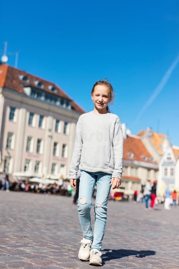 Little girl outdoors. Casual portrait of little girl outdoors in Tallinn old town on summer day royalty free stock images