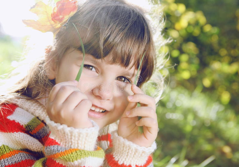 Download Little Girl Outdoors On Sunny Day Stock Photo - Image of grass, smiling: 28232756