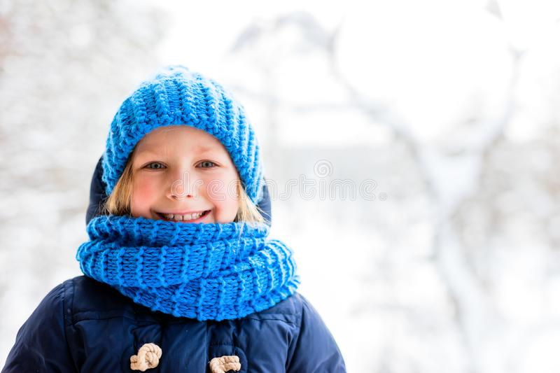 Little girl outdoors on winter stock photos