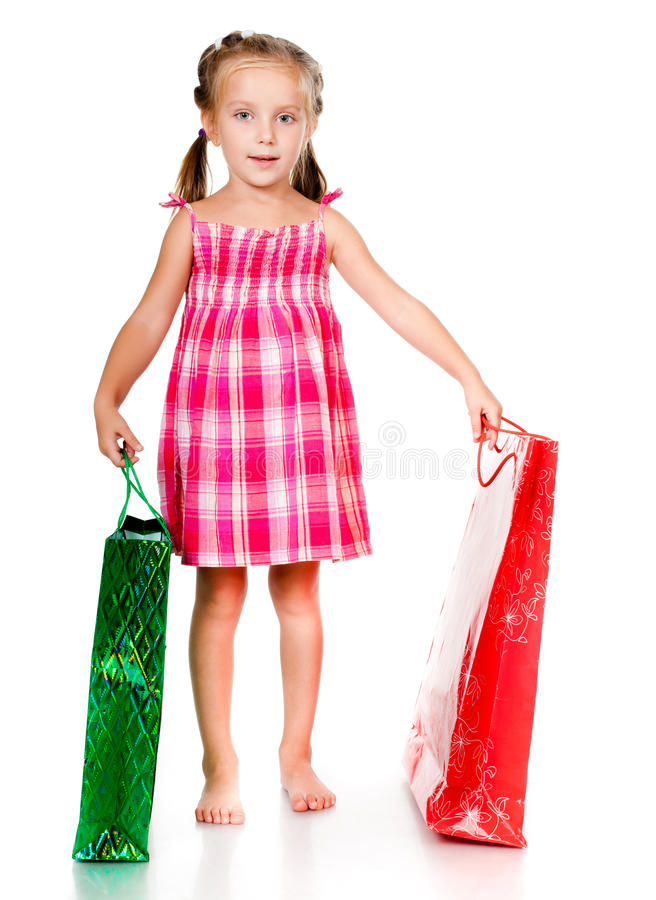 Little girl with the package. Isolated on a white background royalty free stock photo
