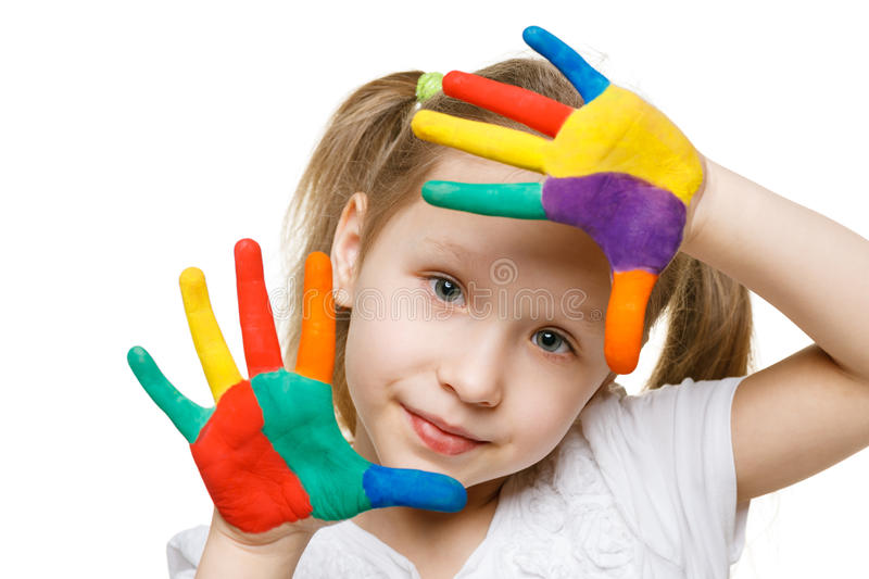 Little girl with painted palms. Closeup of little girl with painted palms over white background stock image