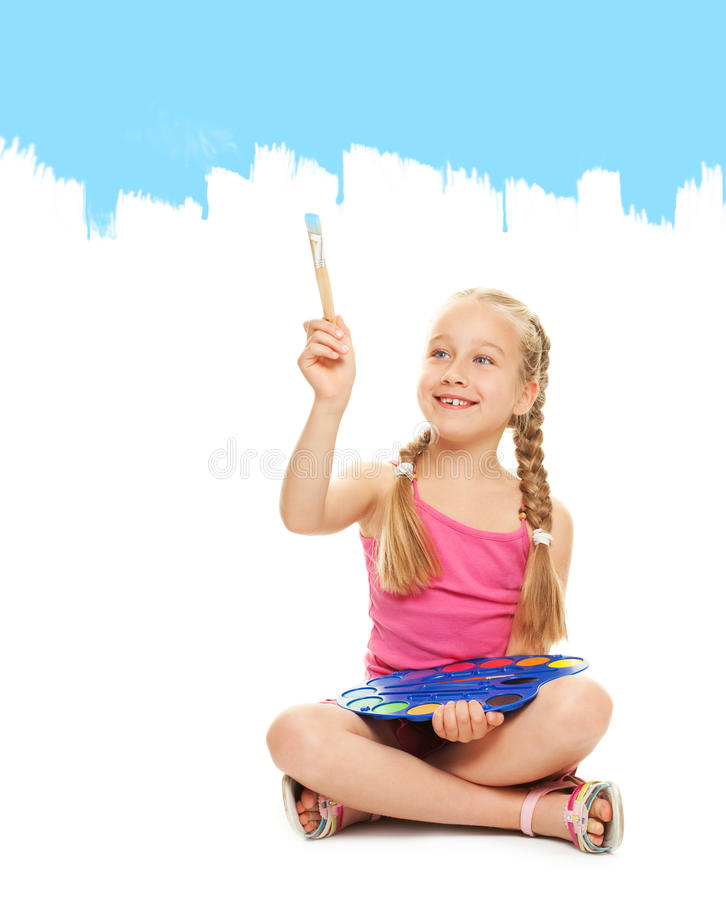 Little girl painting with blue paint royalty free stock image