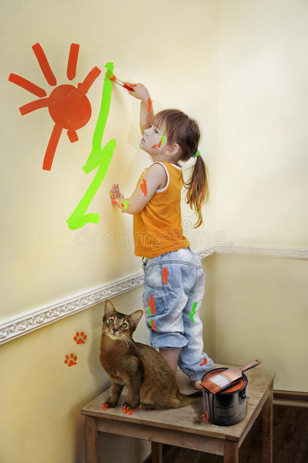Little girl Painting her room. Little girl with cat designed the wall