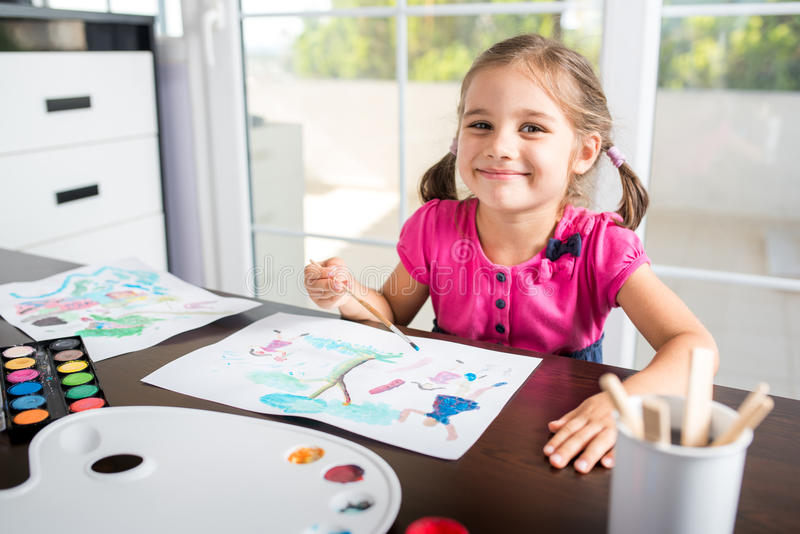 Little Girl Painting Picture royalty free stock photos