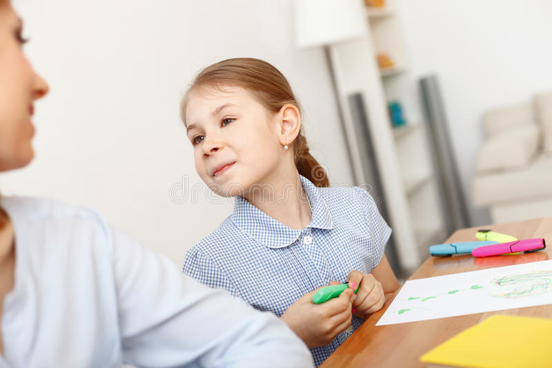 Little girl painting picture royalty free stock images