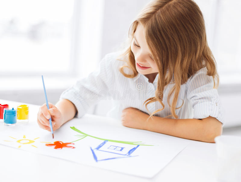 Little girl painting picture royalty free stock photo