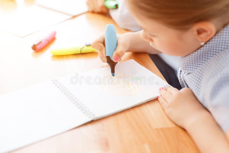 Little girl painting picture stock image