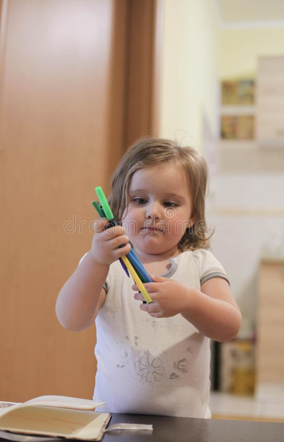 Little girl painting and writing stock illustration