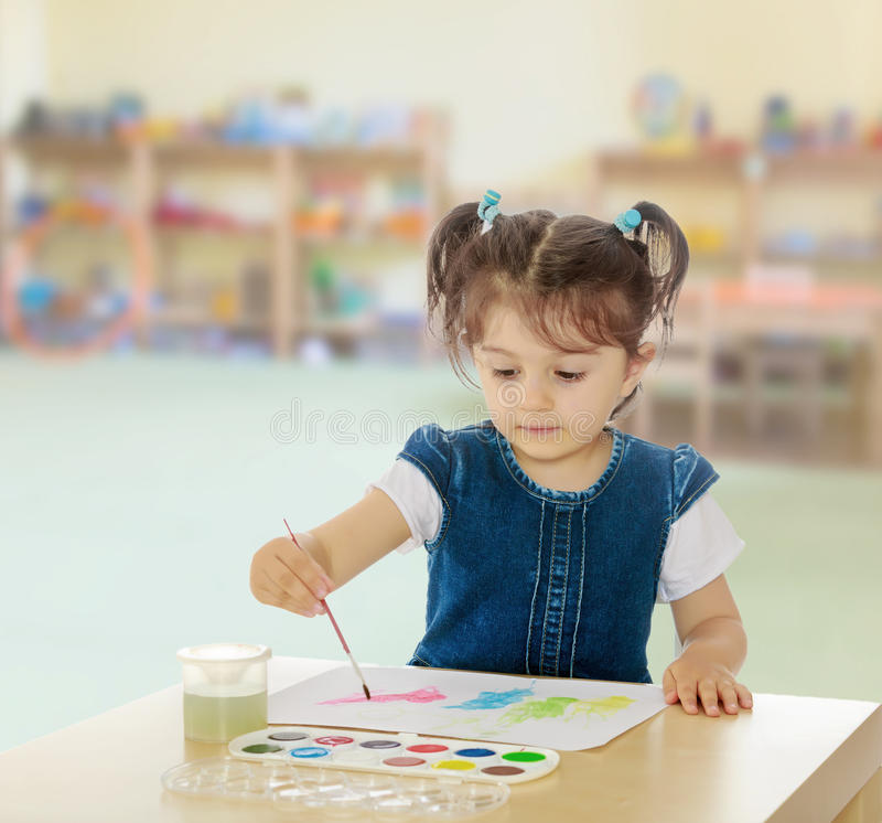 Free Little Girl Paints With Watercolors At The Table. Royalty Free Stock Photo - 89934345
