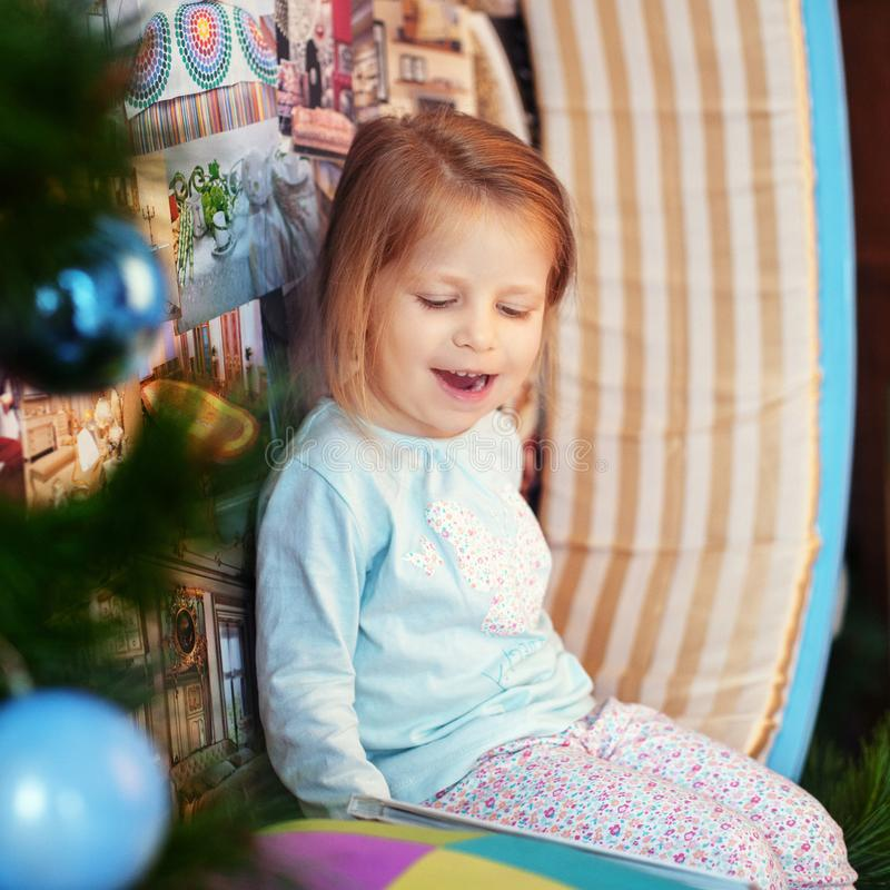 Little girl in pajamas laughing. The concept of Christmas and Ne. Little girl in pajamas laughing. Square. The concept of Christmas and New Year stock photos