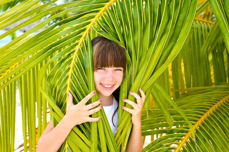 Little girl in palm tree stock image