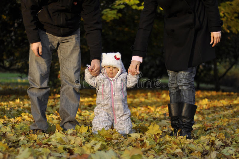 Little girl with parents royalty free stock photography