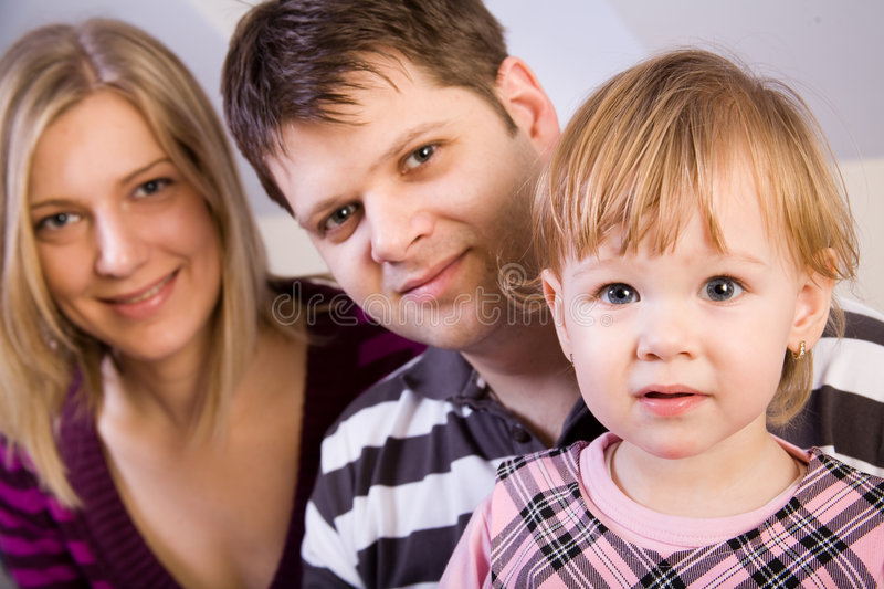 Little girl with parents stock image