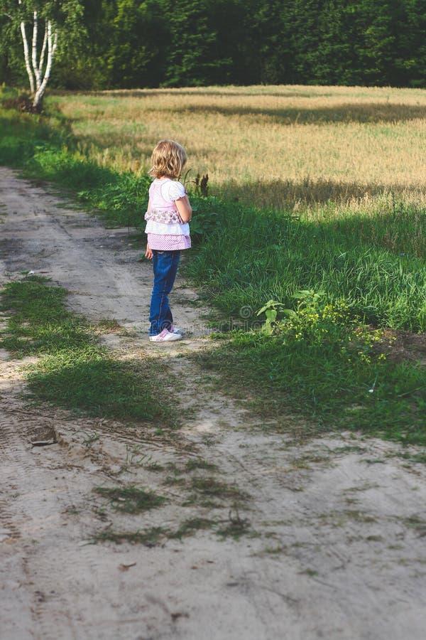 Little girl on path stock photos