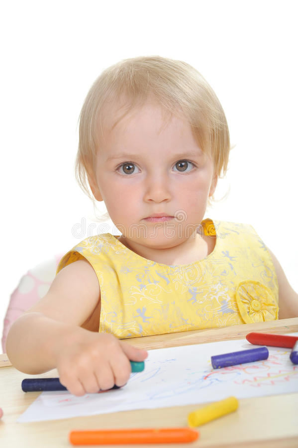 Little girl with pencils. Beautiful little girl in white portrait royalty free stock images