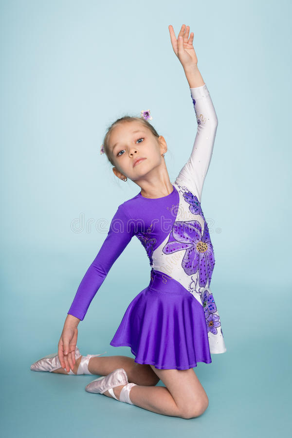 Little girl performs a dance stock photography